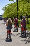 Riding Rental Bikes next to the Willamette River in Portland Oregon stock photo