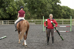 Riding school pupil and instructor Royalty Free Stock Image