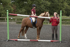 Riding school pupil and instructor Stock Photography