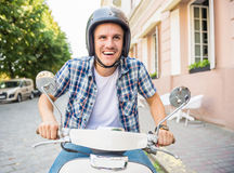 Riding on scooter Royalty Free Stock Image