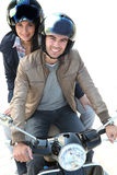 Riding a scooter together Stock Photos