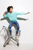 Riding a shopping cart. Stock Images