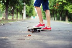 Riding on a skateboard. Man engaged in a single klichnym sport - skateboarding Stock Photos