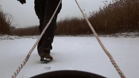 Riding sledge on snow stock video footage