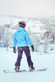 Riding a snowboard down the slope Stock Photo