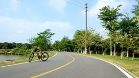 Riding on the Songshan Lake at the weekend. In the morning of the spring, the scenery on the way. Photographed at Songshan Lake in Dongguan Stock Photography