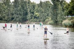 riding on sup boarding at summer weekend. urban water activities royalty free stock photos