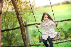 Riding on a swing royalty free stock photography