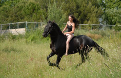 Riding teen and bikini Royalty Free Stock Image