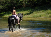 Riding teen and river Royalty Free Stock Photos