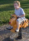 Riding Tiger. Young boy riding playground equipment Royalty Free Stock Images