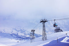 Riding to the top. Cable car in the snowy mountain of the Alps Royalty Free Stock Photos