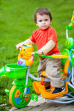 Riding toy bike Stock Image