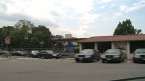 Riding by train station. A view or scene from around town stock video
