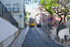 Riding tram in narrow, curvy street, Lisbon Stock Photos