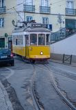 Riding tram in narrow, curvy street, Lisbon Royalty Free Stock Image