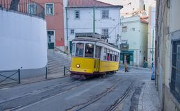 Riding tram in narrow, curvy street, Lisbon Royalty Free Stock Images