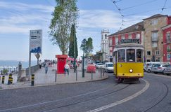 Riding tram in narrow, curvy street, Lisbon Royalty Free Stock Photography