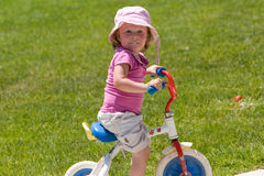 Riding a tricycle Royalty Free Stock Photos