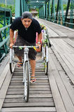 Riding tricycle on Bridge over Pai River at Pai at Mae Hong Son Thailand Royalty Free Stock Images