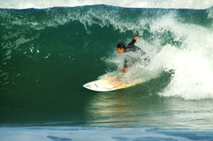 Riding the tube. Surfer riding a big wave Stock Images