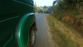 Riding a tuk tuk at sunrise through the mountains and jungle stock video