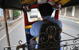 Riding on Tuktuk in Bangkok center city Stock Photos