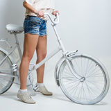Riding vintage bicycle Royalty Free Stock Photo