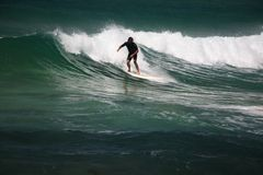 Riding the wave. A surfer surfing a wave in Australia Stock Photo