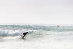 Riding a wave in cornwall Stock Photo