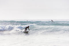 Riding a wave in cornwall Stock Photos
