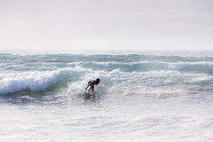 Riding a wave in cornwall Royalty Free Stock Photography