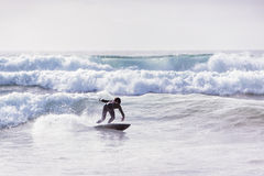 Riding a wave in cornwall Stock Images
