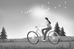 Riding woman on the bike in the field. Of afternoon sky with sunlight Royalty Free Stock Images
