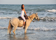 Riding woman in sea Stock Photography