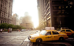Riding yellow taxi cab in New York. NEW YORK CITY - JULY 2: Riding yellow taxi cab on July 2, 2011 in New York City. Taxicabs with their distinctive yellow paint Royalty Free Stock Photo