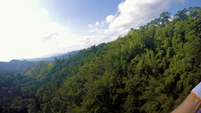 Riding Zip-Line in Lush Jungles of Laos. Shot with GoPro 4 Silver stock video