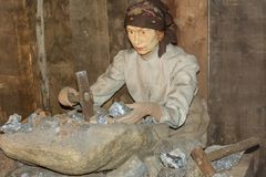 Ridnaun Valley Ridanna in South Tyrol, Italy-may 27,2017: interior hall of South Tyrol mining Museum:reproduction of a female fi. Gure at work with the royalty free stock photography
