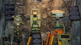 Ridnaun Valley Ridanna in South Tyrol, Italy - may 27,2017: interior hall of South Tyrol mining Museum. the miners` tools in mi. Nes: old Theodolite and moderne royalty free stock photo