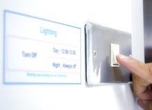 Riduca il consumo di elettricità Immagini Stock