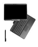 Riduca in pani il computer portatile del PC su priorità bassa bianca Immagini Stock