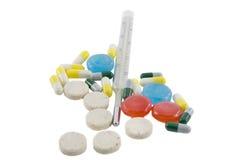 ridurre in pani, pillole e termometro Fotografie Stock Libere da Diritti