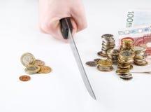 Riduzione dei soldi Immagine Stock
