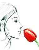 Riechen einer Blume Stockfoto