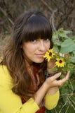 Riechen Sie die Blumen Stockfotografie