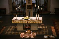 Rieden Germany 15.04.2018 Altar Setup with jesus Christ on the Cross hang behind the altar of the local church of Rieden royalty free stock photos