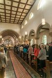 Rieden Germany 15.04.2018 Priest holding church service in front of crowd in theinterior of a church. Rieden Germany 15.04.2018 - Priest holding church service royalty free stock photo
