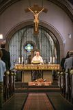 Rieden Germany 15.04.2018 Priest holding church service in front of crowd in theinterior of a church. Rieden Germany 15.04.2018 - Priest holding church service royalty free stock photography