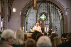 Rieden Germany 15.04.2018 Priest holding church service in front of crowd in theinterior of a church stock image