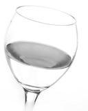 Riegue en un vidrio de vino Foto de archivo libre de regalías